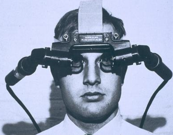 """The Sword of Damocles head-mounted display. """"The ultimate display would, of course, be a room within which the computer can control the existence of matter,"""" Sutherland wrote in his 1965 essay. (Credit: Ivan Sutherland """"The Ultimate Display"""")"""